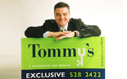 steve slicker with tommys sign Copy